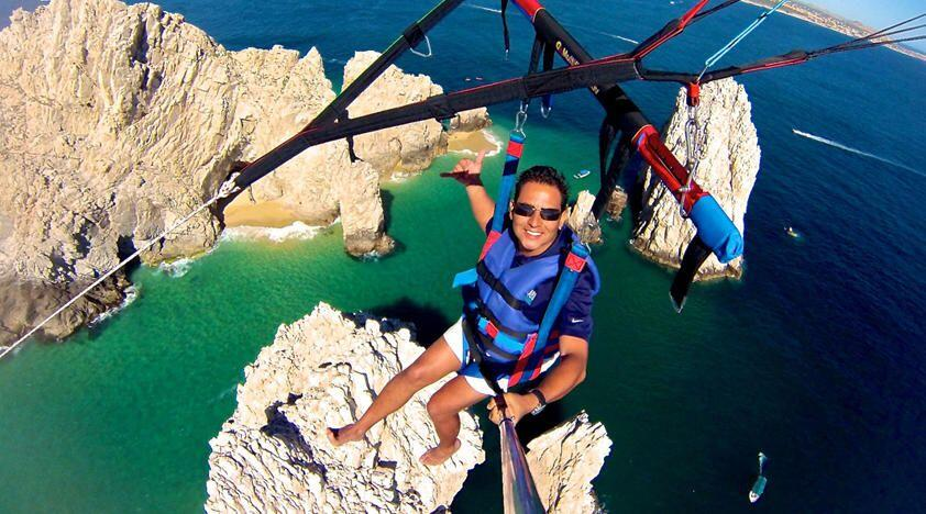 capture the spectacular views of Medan Beach, Lands end and the Pacific Ocean, whilst Parasailing in Cabo San Lucas